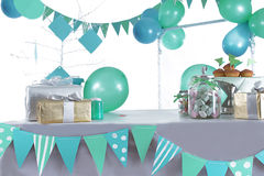 Blue and green colored birthday party table. With sweets and decorations stock images