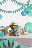 Blue and green colored birthday party table. With sweets and decorations stock photo