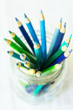 Blue and Green Colored Pencils From Above Stock Photos