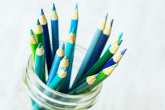 Blue and Green Colored Pencils In Glass Jar Close Up Royalty Free Stock Images
