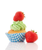Blue and green cupcake with strawberries Stock Photography