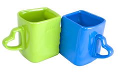 Blue and green cups Stock Photos