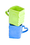 Blue and green cups Royalty Free Stock Images