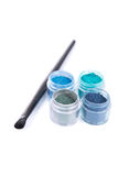 Blue and green eye shadows with make-up brush Stock Images