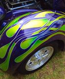 Blue and green flames. Of a classic hot rod Stock Photos