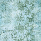 Blue and green floral vintage grungy background. With antique text Stock Image