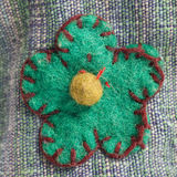Blue-green flower embroidered onto fabric Royalty Free Stock Photo