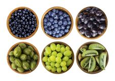 Blue and green food isolated on white background. Collage of different fruits and berries. Blueberries, blueberries, grapes, goose stock photography