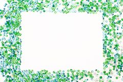 Blue and green frame on white background. Frame made with blue and green beads with copy space Stock Photo