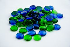 Blue and green glass pieces. On white Stock Images