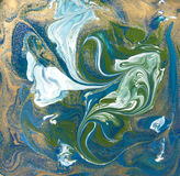 Blue, green and gold liquid texture. Hand drawn marbling background. Ink marble abstract pattern Stock Photos