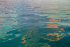 Artistic blue green golden sea water stock images