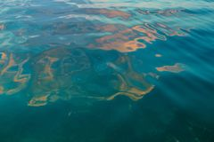 Artistic blue green golden sea water royalty free stock image