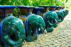 Blue and green grossy textured stone  elephant chairs Royalty Free Stock Photos