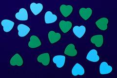 Blue and green hearts. On dark blue background Royalty Free Stock Photos