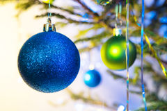 Blue and green holiday balls with christmas tree Royalty Free Stock Images
