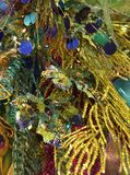 Blue Green Holiday Decorations. Closeup of a spray of blue, gold and green Christmas decorations...also possible use for Mardi Gras