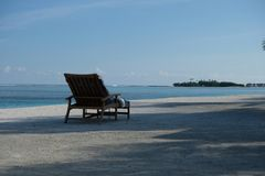 Outdoor deck chair of Four Seasons Hotel in Maldive island resort stock photo