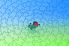 Blue-green jigsaw with the last piece upstanding Stock Photo