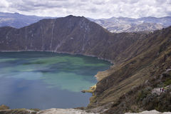 Blue green lake in Quilotoa Volcano. Ecuador taken in early morning stock images