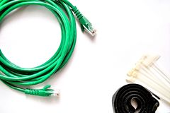 Blue and Green LAN cable with cable ties and cable strap. royalty free stock photos