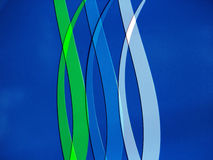 Blue and Green lines curving on Blue Background Royalty Free Stock Image