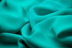 Blue, green, marine silk tender colored textile, elegance rippled material Royalty Free Stock Photography