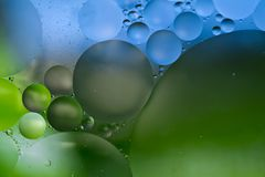 Blue and Green Oil and water bubble abstract background Stock Photos