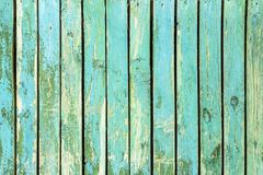 Blue green old wood background - Weathered wooden planks in vert. Blue green old wood background - Weathered wooden vintage planks in vertical grunge wall royalty free stock photography