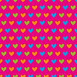 Blue, green and orange hearts seamless pattern on a pink background Royalty Free Stock Photos