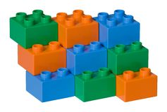 Blue, green and orange plastic toy bricks Stock Images