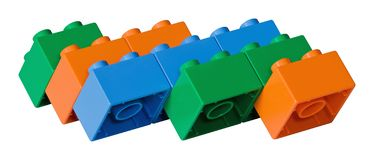 Blue, green and orange toy bricks Stock Image