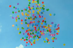 Blue Green Orange Yellow and Red Balloons on Blue Sky Royalty Free Stock Photography