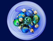 Blue and Green Ornaments. This is a festive image of beautiful hand decorated blue and green Christmas ornaments arranged in a blue hand blown glass bowl Stock Photography