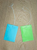 Blue and green paper envelopes with white  string Royalty Free Stock Image