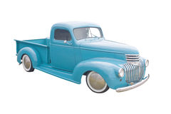 Blue green pickup. Retro blue green pickup with moon hubcaps Royalty Free Stock Photos