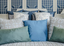 Blue and green pillow on bed in luxury bedroom Royalty Free Stock Photo