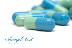 Blue-green pills Royalty Free Stock Images