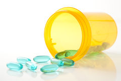Blue Green Pills with Prescription Bottle Royalty Free Stock Images
