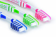 Blue, green, pink toothbrushes isolated on white background Royalty Free Stock Photos