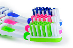 Blue, green, pink toothbrushes isolated on white background stock photos