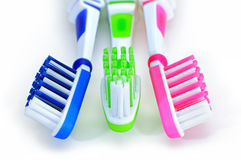 Blue, green, pink toothbrushes isolated on white background Royalty Free Stock Photo