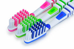 Blue, green, pink toothbrushes isolated on white background Royalty Free Stock Photography