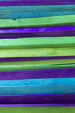 Blue, Green and Purple colored popsicle sticks background. This is a photograph of Blue, Green and Purple colored popsicle sticks background royalty free stock photography