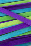 Blue, Green and Purple colored popsicle sticks background. This is a photograph of Blue, Green and Purple colored popsicle sticks background stock images