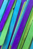 Blue, Green and Purple colored popsicle sticks background. This is a photograph of Blue, Green and Purple colored popsicle sticks background royalty free stock images