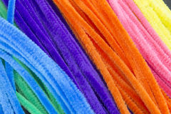 Blue,Green,Purple,Orange,Pink and Yellow pipe cleaners background. This is a photograph of Blue,Green,Purple,Orange,Pink and Yellow pipe cleaners background Stock Image