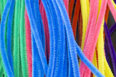 Blue,Green,Purple,Orange,Pink and Yellow pipe cleaners background. This is a photograph of Blue,Green,Purple,Orange,Pink and Yellow pipe cleaners background Royalty Free Stock Photos