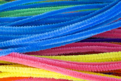 Blue,Green,Purple,Orange,Pink and Yellow pipe cleaners background. This is a photograph of Blue,Green,Purple,Orange,Pink and Yellow pipe cleaners background Stock Images