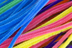 Blue,Green,Purple,Orange,Pink and Yellow pipe cleaners background. This is a photograph of Blue,Green,Purple,Orange,Pink and Yellow pipe cleaners background Stock Photo